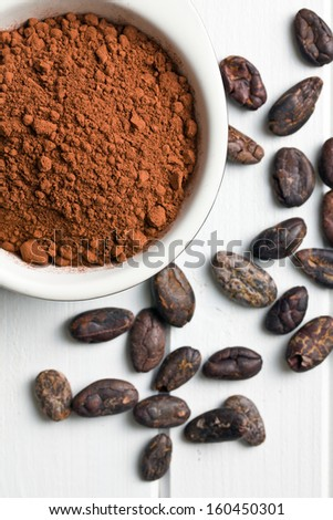 top view of cocoa powder and cocoa beans - stock photo