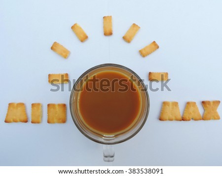 Top view of coffee cup and biscuits on white table,soft focus.