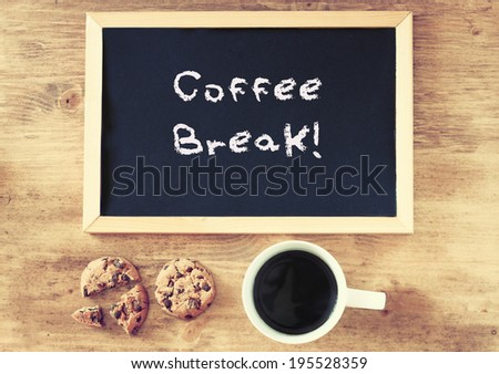 top view of coffee cup cookies and blackboard with the phrase coffee break written on it. - stock photo