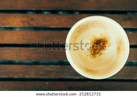 Top view of coffee cup on wooden table - vintage effect style pictures - stock photo