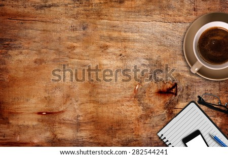 top view of coffeE ,notepad with pen and phone - stock photo