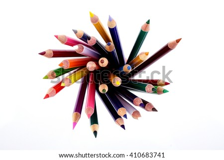 Top view of color pencils against white background - stock photo