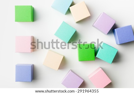 top view of colorful blank paper boxes on white background. copy space available - stock photo