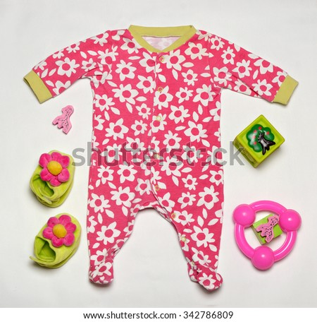 top view of colorful fashionable baby girl set of clothes with toys and other stuff - stock photo