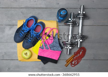 top view of colorful fitness equipment on wooden floor - stock photo