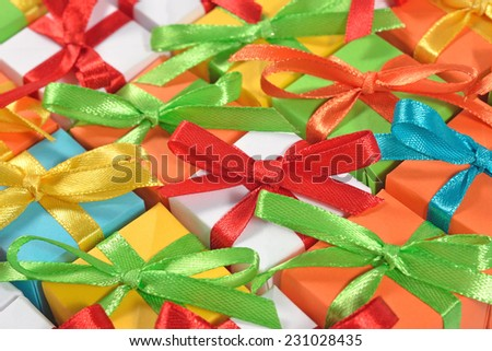 Top view of colorful gifts as background