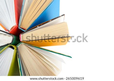 Top view of colorful hardback books in a circle isolated on white background. Back to school. - stock photo