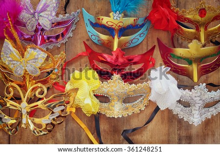top view of colorful Venetian masquerade masks. retro filtered image  - stock photo
