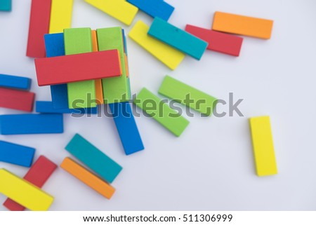 Top view of colorful wood blocks stack game with color dice