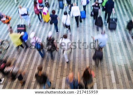 top view of commuters in motion blur - stock photo