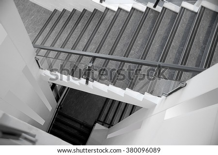 Top view of contemporary staircase hallway. Abstract black and white interior fragment in minimalist style. - stock photo