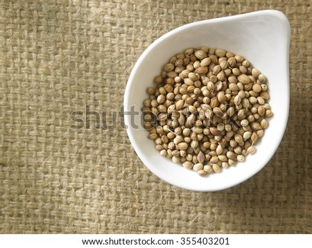 top view of coriander seeds in a container