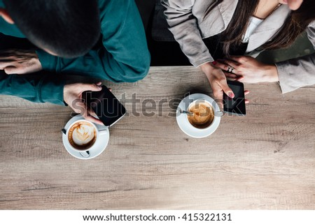 Top view of couple in a cafe. New generation communication concept. - stock photo