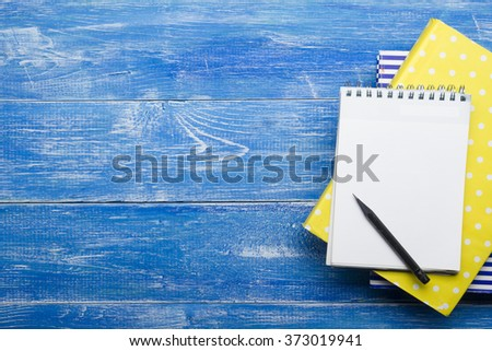 Top View of Creative Writing Concept With Pencils, Book, Notepad on Wooden Table. Copy space for text - stock photo