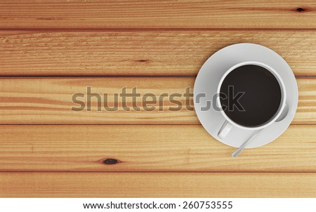 Top View of Cup of Coffee on Saucer with Spoon on Wooden Table with Copy Space - stock photo