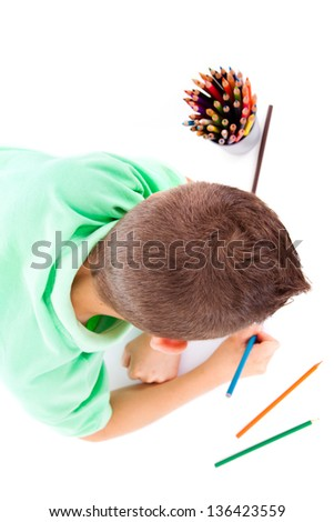 Top view of cute child draw with colorful crayons, isolated over white - stock photo
