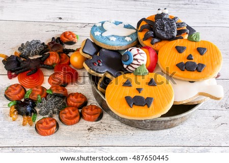 Top view of delicious colorful halloween cookies on wooden table