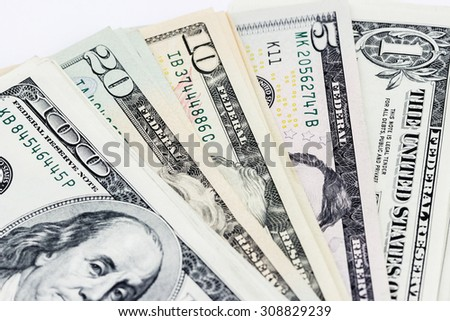 Top view of different dollar bills folded fan - stock photo