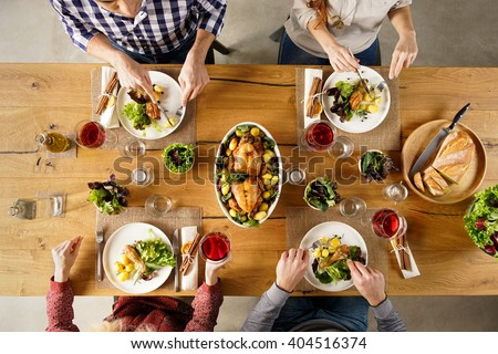 dinner table top view. top view of dining table with salad and roasted chicken potatoes. high angle dinner d