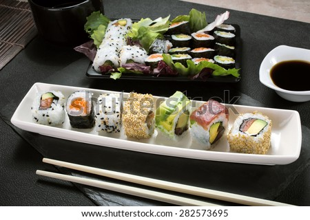 top view of dish with sushi menu assorted on the table restaurant / sushi platter - stock photo