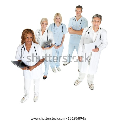 Top view of doctors and surgeons looking up on white background - stock photo