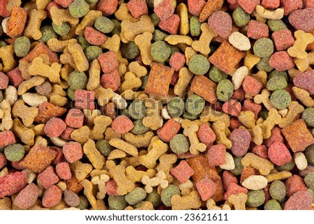 Top  view of dog food. Red, green and brown dog treats.