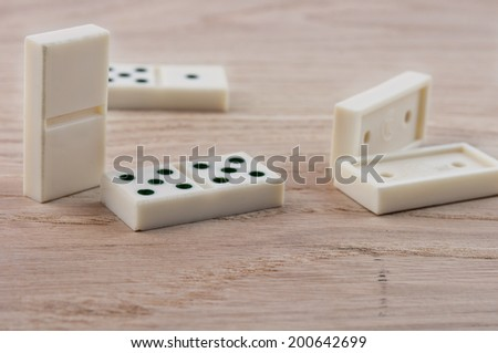 top view of dominoes playing on wooden table