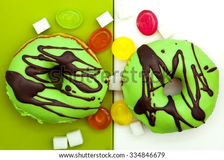 top view of donuts and colorful candies - stock photo