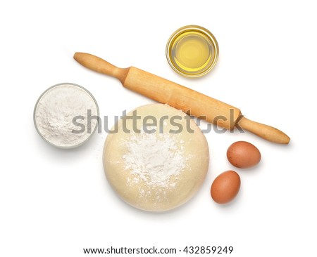 Top view of dough and baking  ingredients isolated on white - stock photo