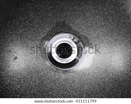 top view of drain hole in marble sink. black and white color. - stock photo