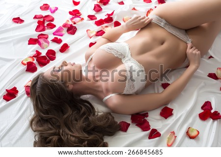 Top view of dreamy model advertises sexy lingerie - stock photo