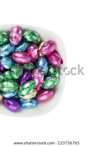 Top view of Easter candies in a bowl.