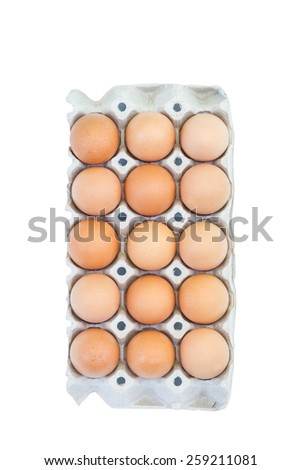 Top view of eggs in package on white background - stock photo