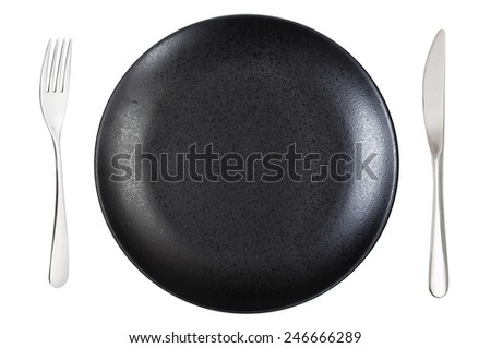 top view of empty black dinner plate with fork and knife isolated on white background - stock photo