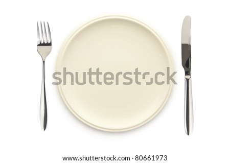 Top view of empty white dish knife and fork on white background - stock photo