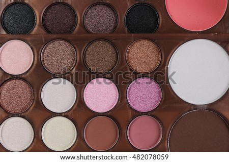 Top view of eye shadow, pink and brown tone make up palette