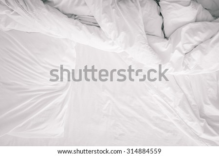 Top view of f bedding sheets and pillow after sleep - stock photo