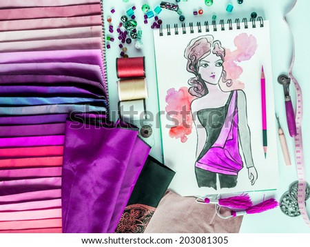 Top view of fashion designer material sample and hand-drawn illustration - stock photo