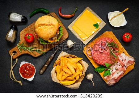 Top View of Fast Food Burger Sandwich with French Fries and Ground Meat