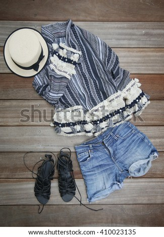 Top view of female essentials festival, vacation fashion items - stock photo
