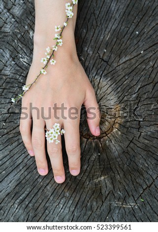top view of flowers branches spirea on a hand young woman