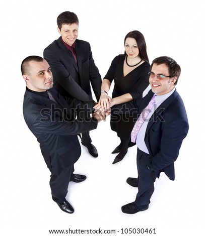 Top view of four business people look up and laid their hands on each other - stock photo