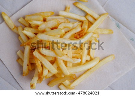 Top view of french fries on Brown paper background. Vintage, selective focus and blank space.