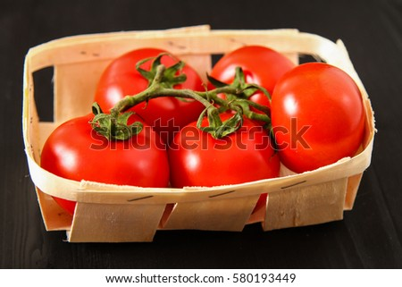 Top view of fresh red tomatoes, isolated on dark background