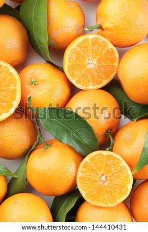 Top view of fresh tangerines with leaves. - stock photo