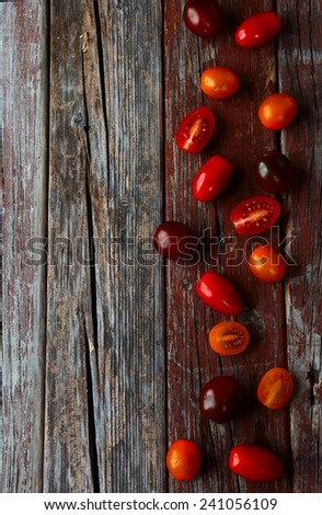 top view of fresh tomatoes on rustic wooden table with copy space - stock photo