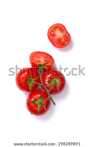 Top view of fresh tomatoes, whole and half cut, isolated on white background  - stock photo