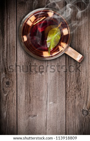 Top view of fruit tea on wooden plank table - stock photo