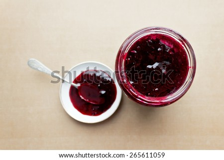 Top view of fruity jam in a glass jar - stock photo
