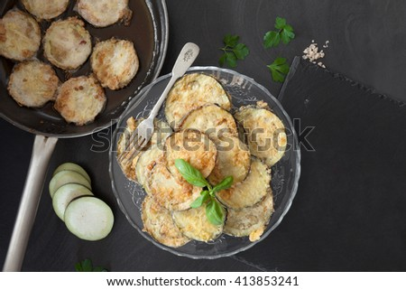 Top view of frying pan and plate with fried eggplant.  - stock photo